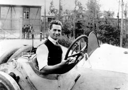 Ralph DePalma at the Untertürkheim plant in July 1914 at the wheel of a Mercedes Grand Prix racing car.